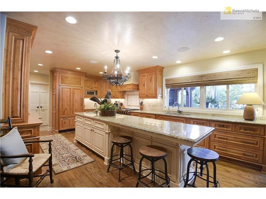The remodeled kitchen offers loads of custom built-ins and stainless steel appliances. (photo 5)