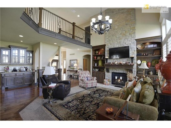 Ceiling to floor stone fireplace, built-ins, & plantation shutters brings custom quality finishings to this home. (photo 3)