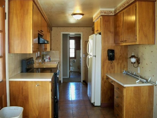 Kitchen with refrigerator, electric cook top range, and dishwasher. (photo 4)