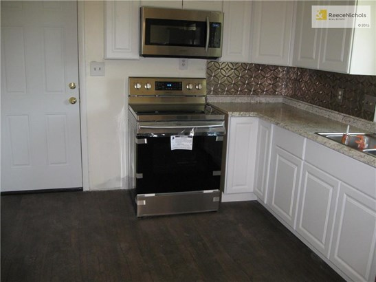 New kitchen cabinets, new stainless range, dishwasher, microwave and refrig all staying (photo 3)