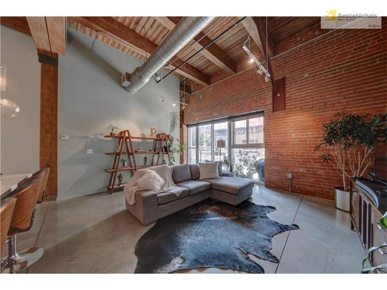Living area. Beautiful exposed brick & large windows. (photo 4)