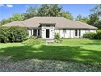 Mr. and Mrs. Clean live here and welcome you to enjoy all the fantastic features of this beautiful home sheltered by 20 acres of privacy.  The bushes on the left side of the house offer protection to the humming birds. Construction is 2