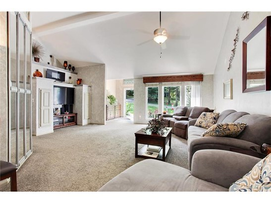 Another view of this fantastic GREAT room!  Notice the hummingbird feeders outside the windows.. (photo 4)