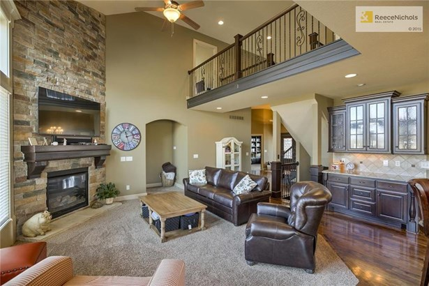 Great Room with Soaring Ceilings and Stone Fireplace (photo 5)