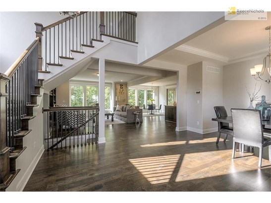 Open floor plan readily flows from the eye-catching entry through the dining area to kitchen and great room (photo 3)