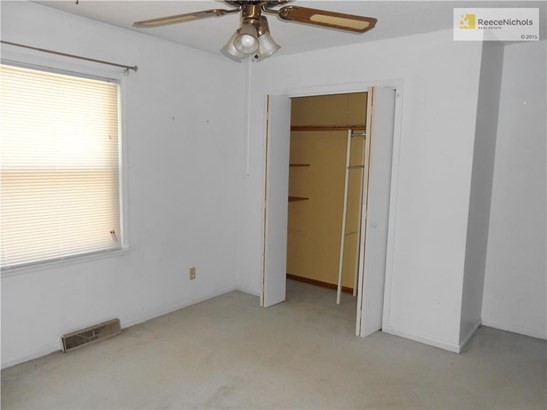 BEDROOM 2 HAS A LARGE CLOSET WITH SHELVES.  ALMOST EVERY ROOM HAS A HANDSOME CEILING FAN FOR EXTRA COMFORT. (photo 5)