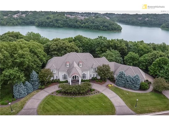 Luxury Estate sits on gated paved street over looking private lake (photo 1)