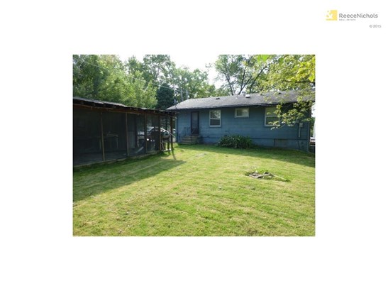 Screened in porch is attached to garage.  Nice level backyard! (photo 4)