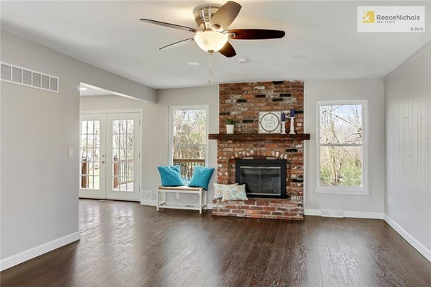 The Great room opens into the kitchen and has a fireplace. (photo 5)