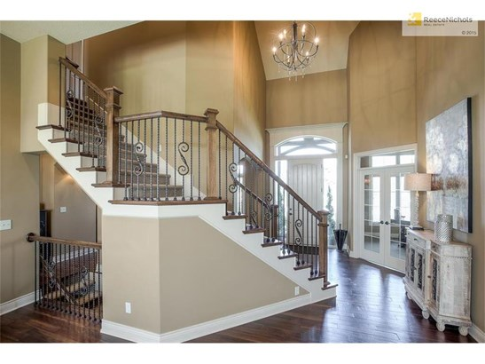 Fabulous & spacious two story entry with arched doorways leading to formal dining room and French doors leading to study. (photo 4)