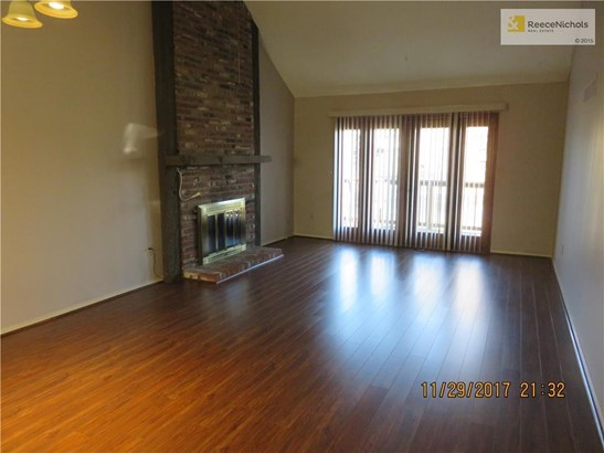 Living Room w/Fireplace & Deck (photo 2)