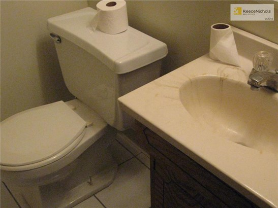 Half bath with tile floor off recreation on lower level (photo 5)