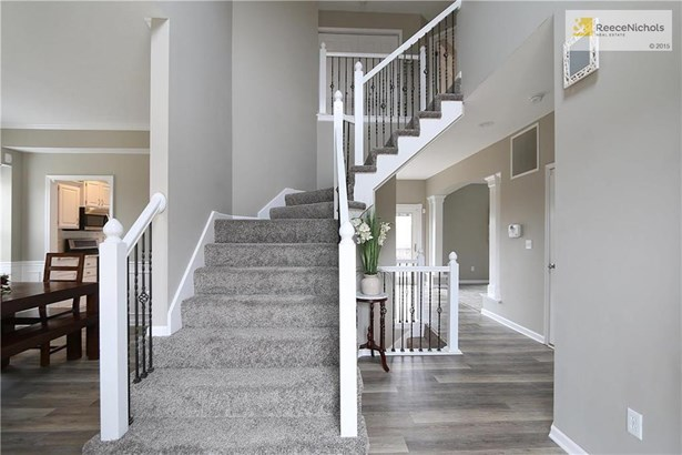 Gorgeous entryway! All new flooring and neutral grays through home. All the baseboards are new as well! (photo 2)