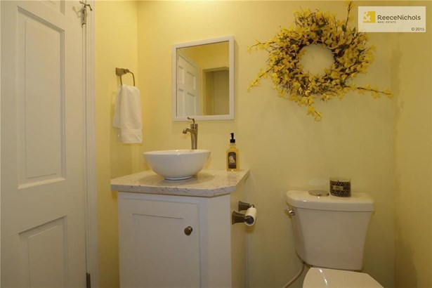 Perfectly placed Powder Room off Kitchen/garage entry!  Also holds the FIRST FLOOR LAUNDRY AREA! (photo 5)