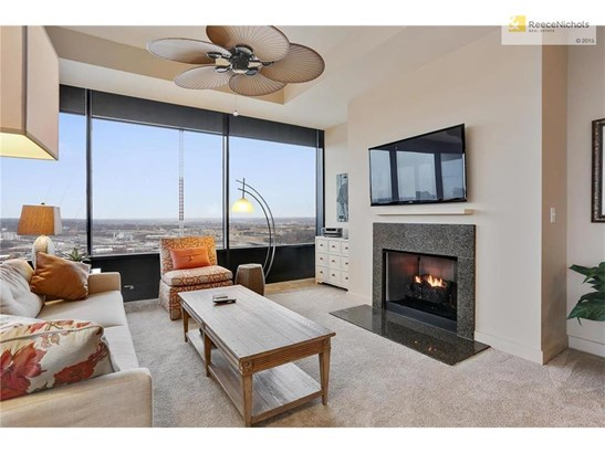 Cozy living room with fireplace and expansive views. (photo 3)