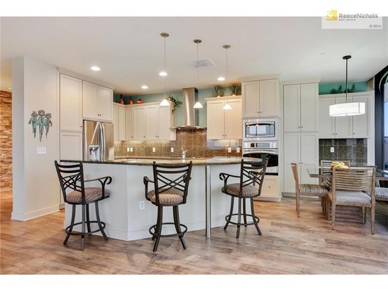 Beautiful Chefs kitchen featuring: 5 burner gas cooktop, all stainless appliances, convection oven, generous counter space, inviting island. (photo 5)