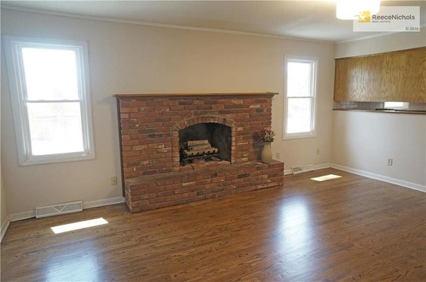 LIVING ROOM WITH BRICK FIREPLACE (photo 5)