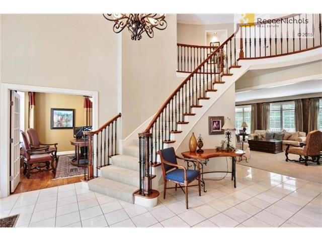 Open entry flows seamlessly into the home office, formal sitting room, or formal dining room. (photo 3)