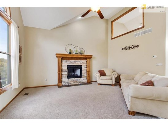 Enter into the light and bright main-level living room with fireplace and vaulted ceilings (photo 4)