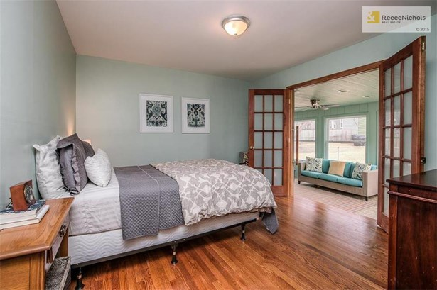 Master bedroom has hardwood floors and French doors which open to all season sunroom. (photo 5)