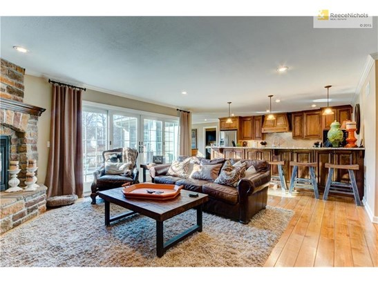 Wide plank wood flooring, beautiful fireplace,  bright and light, custom cabinetry, kitchen open to the family room, everything you want is right here. (photo 4)