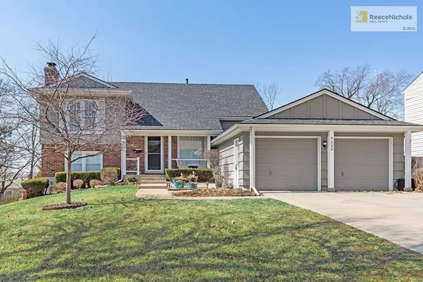 This one scores a 10 on curb appeal! Love that covered porch to wave to neighbors from! (photo 1)