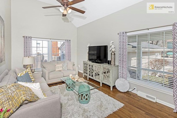 Vaulted ceiling, updated light fixtures, new windows and gorgeous hardwoods make this a dynamite living room. (photo 2)
