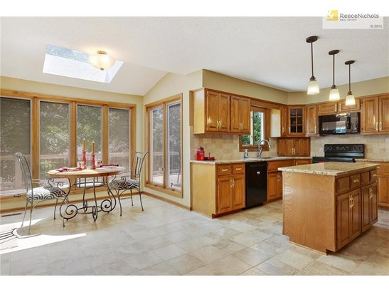 View of sunroom & kitchen from family room. (photo 4)