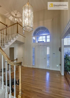 Formal living room with wall of Plantation Shutters (photo 2)