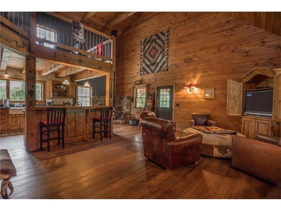 Drama greets you when you open the door of the entry!   Soaring cathedral ceilings and wood beams along with wide plank flooring make this dramatic design something SPECIAL! (photo 3)