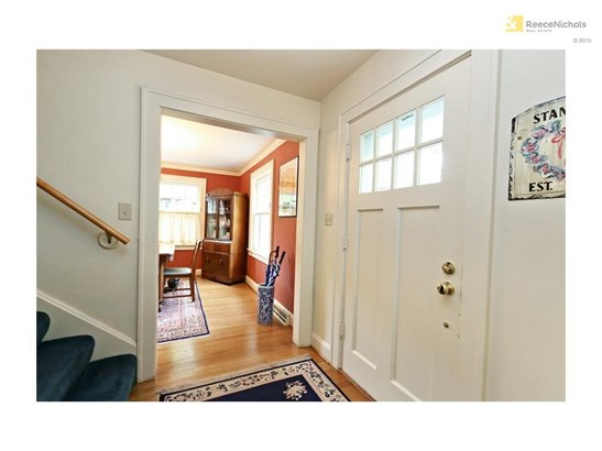 Greet guests at the home's front foyer. (photo 2)