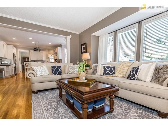 Wonderful open flow between the living room and kitchen perfect for entertaining! (photo 3)