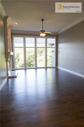 Once this was a carpeted Great Room/Living Room, now it has beautifully finished oak hardwood flooring with a nice warm tone.  Warm yourself by the fire and enjoy the extremely private and treed back yard. (photo 4)