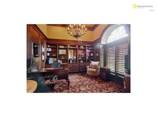 Custom built-ins, grand chandelier and vaulted ceilings - everything you want in a home office! (photo 3)