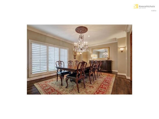 The stunning formal dining room is ready for your next dinner party. (photo 4)