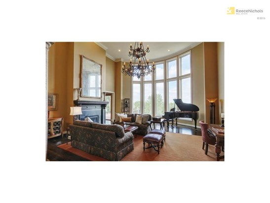 The elegant great room boasts soaring two story ceilings and floor to ceiling windows. (photo 5)