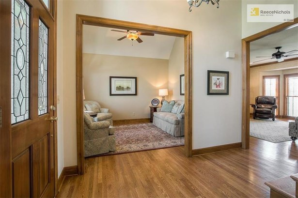 Formal living room could be easily converted into a private office off the main entrance.  The vaulted ceilings in this room make it feel spacious. (photo 3)