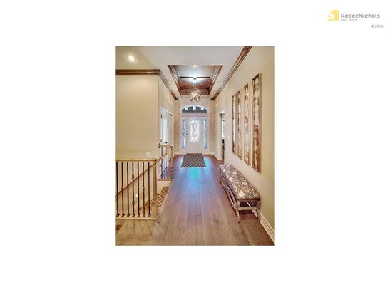 High ceilings with vaults in main entry and custom crafted decorative trim detail. Rocker light switches and lever door handles are all standard. Gorgeous iron and glass front door with generous front porch. (photo 4)