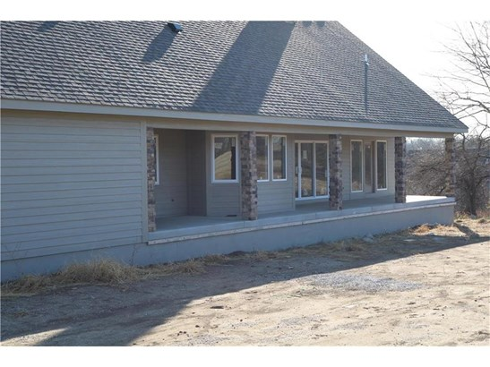 Large Back porch with entry from kitchen and master suite. (photo 3)