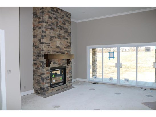 Living room with large doors for view of backyard and gorgeous fireplace. (photo 5)