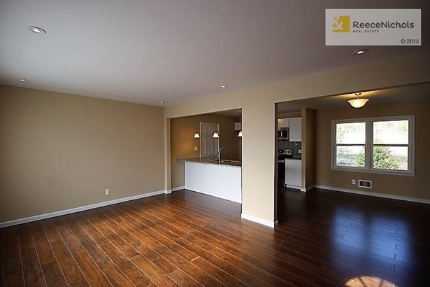 Look how open this is!  Beautiful wood flooring! (photo 2)