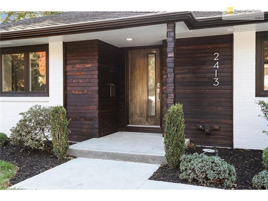 Burnt cedar siding adds character to entry (photo 3)