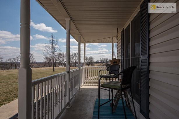 Relax on this oversized wrap around porch and take in the quiet beautiful sits of the country (photo 4)