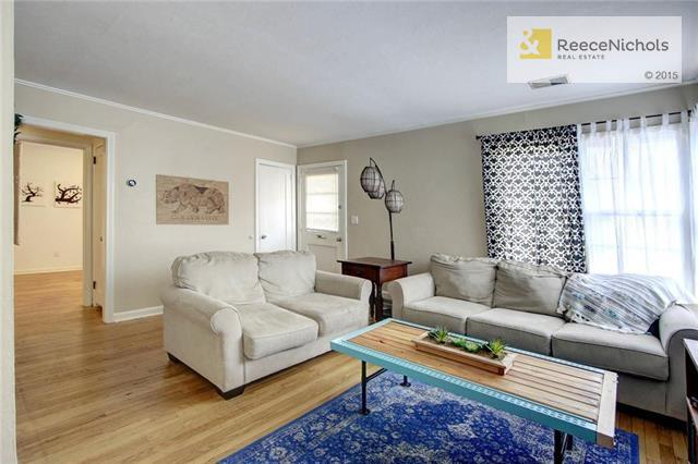 Bright, airy living space featuring hardwood flooring. (photo 2)