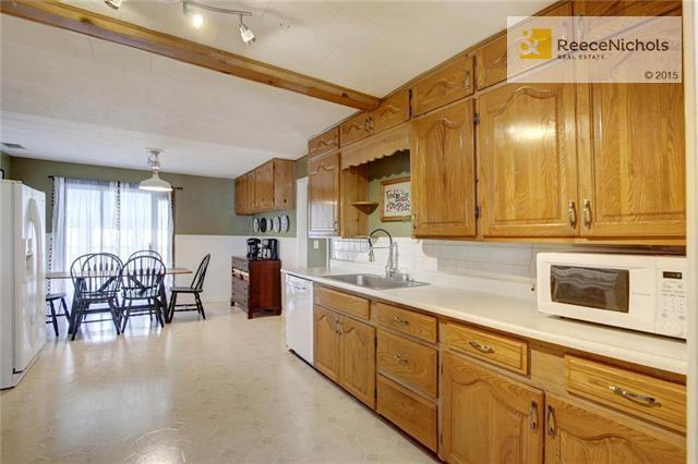 Expansive kitchen provides plenty of cabinet and counter space. (photo 5)