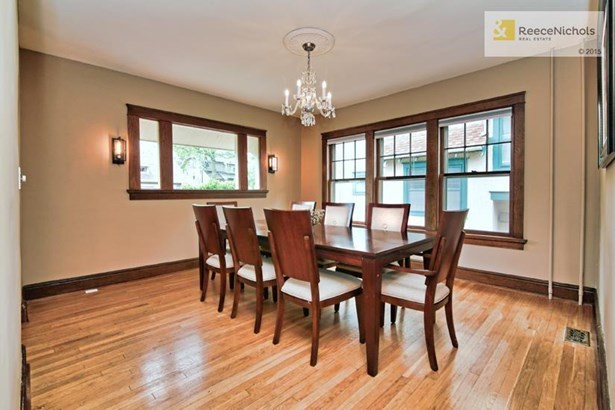 The living room not only has a fireplace, but the unusual archways lead to the family room and dining rooms....perfect for entertaining. (photo 3)