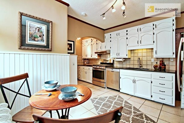 This kitchen has been updated with honed granite counter tops, and all new stainless steel appliances. (photo 5)