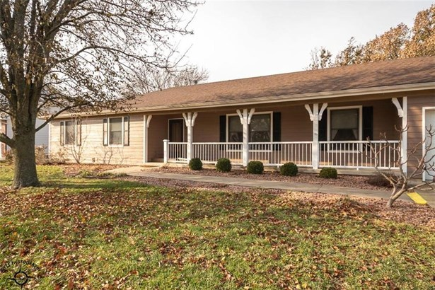 Newer siding with 6 inch exterior walls.  Look at that porch!  All on a large corner lot entering into a nice street of pretty and well maintained homes.