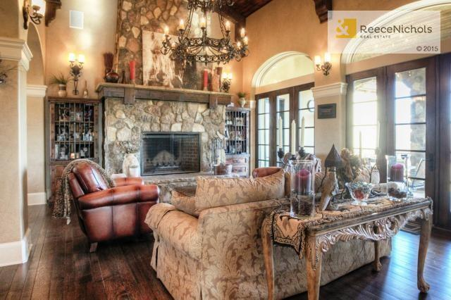 Great Room with dramatic Floor to Ceiling Stone Fireplace (photo 3)