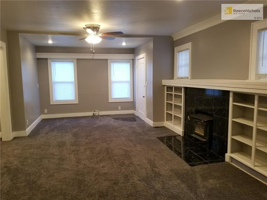 Living room with fireplace and built in shelving (photo 5)